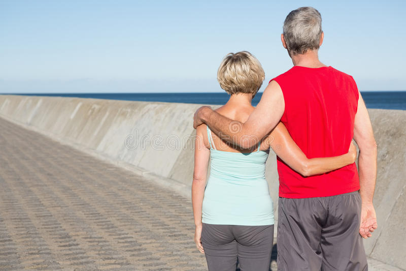 Active senior couple out for a jog. On a sunny day stock photography