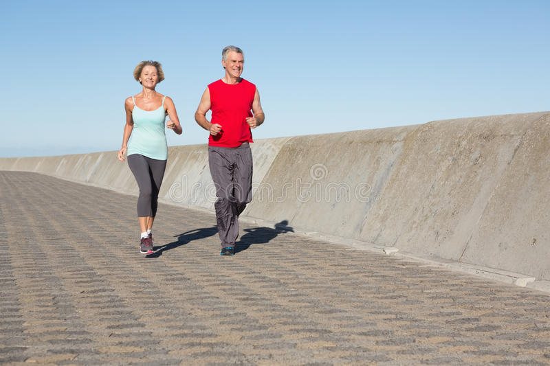 Active senior couple out for a jog stock image