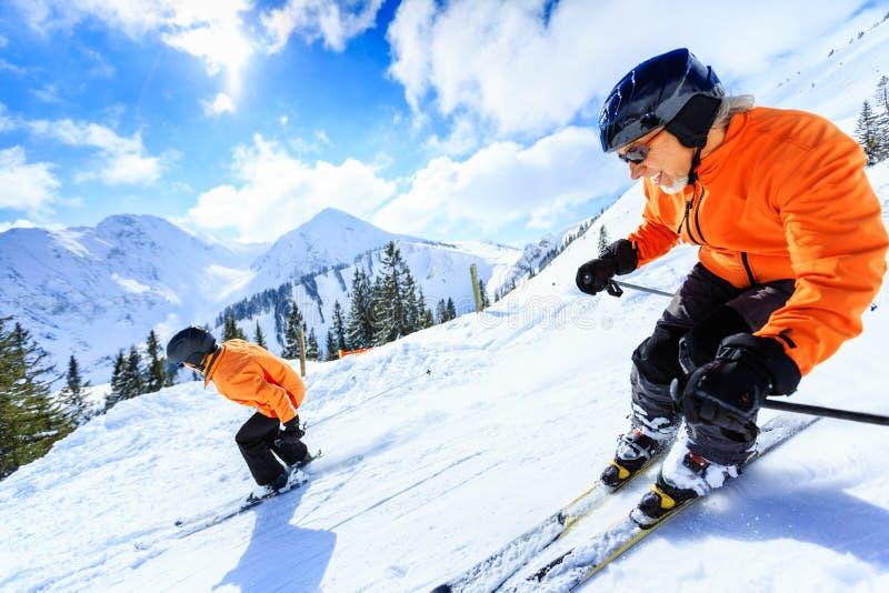 Senior Couple Skiing royalty free stock images