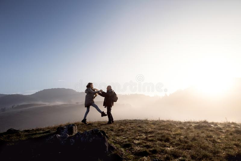 Senior couple on a walk in an autumn nature. stock photos