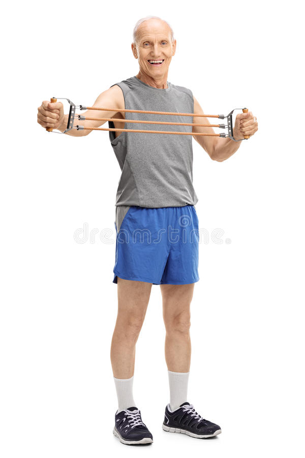 Active senior exercising with resistance band stock image