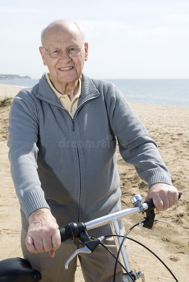 Download Active Senior Man Riding His Bike Stock Photo - Image: 5025410