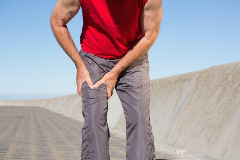 Download Active Senior Man Touching His Injured Thigh Stock Photo - Image: 43641856