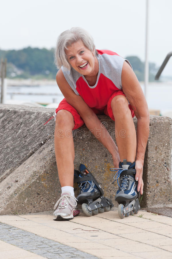 Download Active senior woman stock image. Image of rollerblading - 21581929