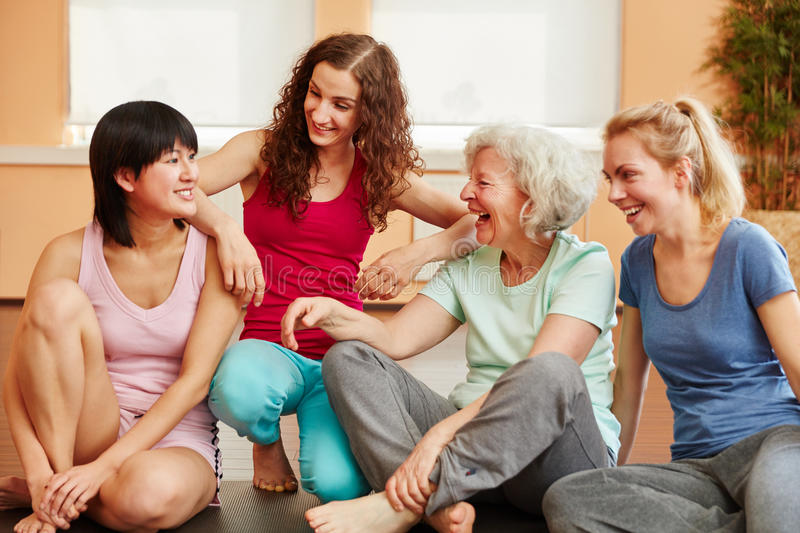 Active senior woman and happy young ladies. Active senior women and happy young ladies at fitness studio stock images