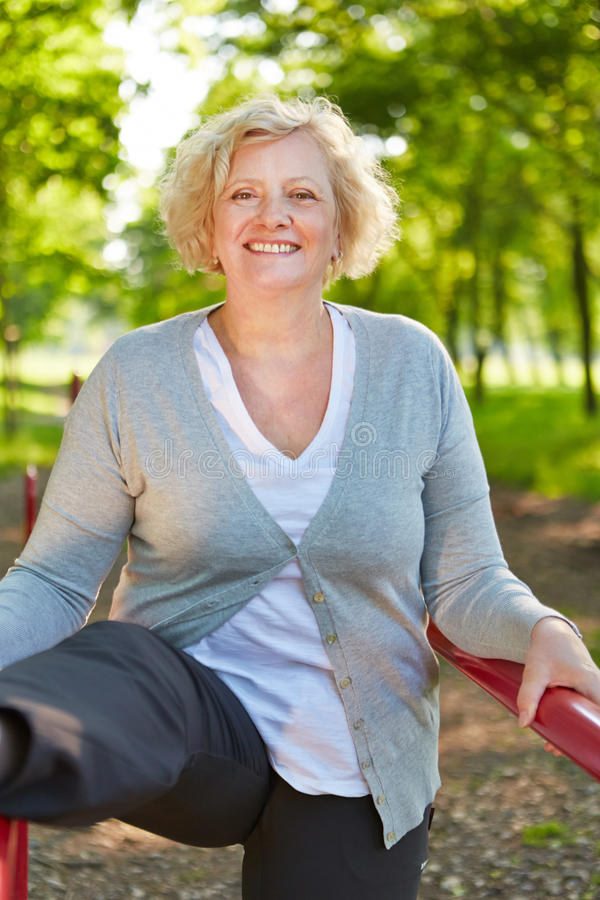 Active senior woman on keep fit trail stock photography