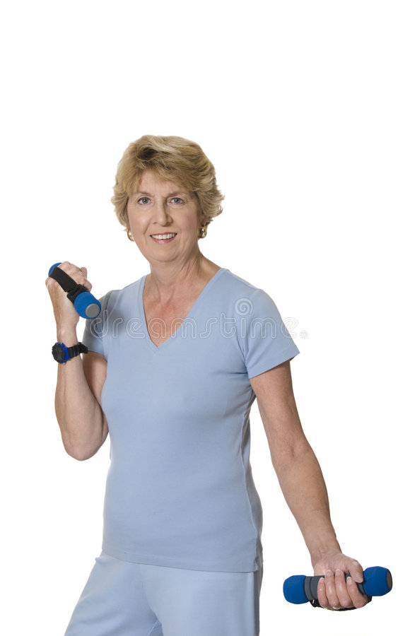 Active senior woman lifting weights royalty free stock photo