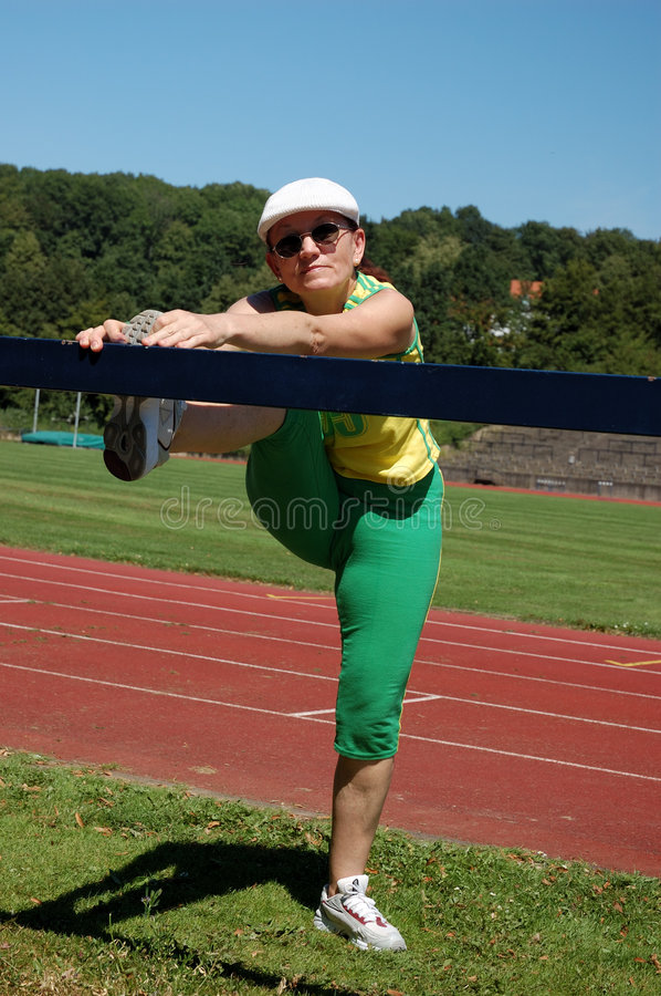Active Senior Woman Stretching Stock Photography