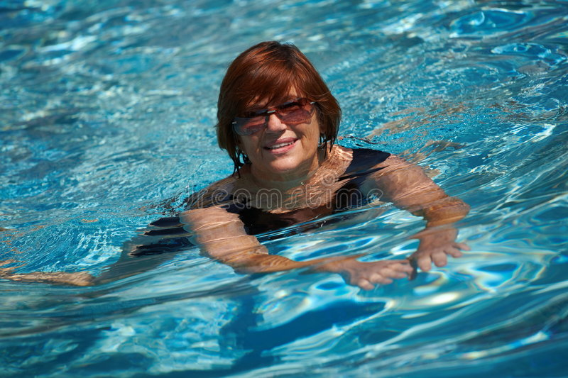 Download Active Senior Woman Swimming Stock Photo - Image of grandmother, happy: 6891332