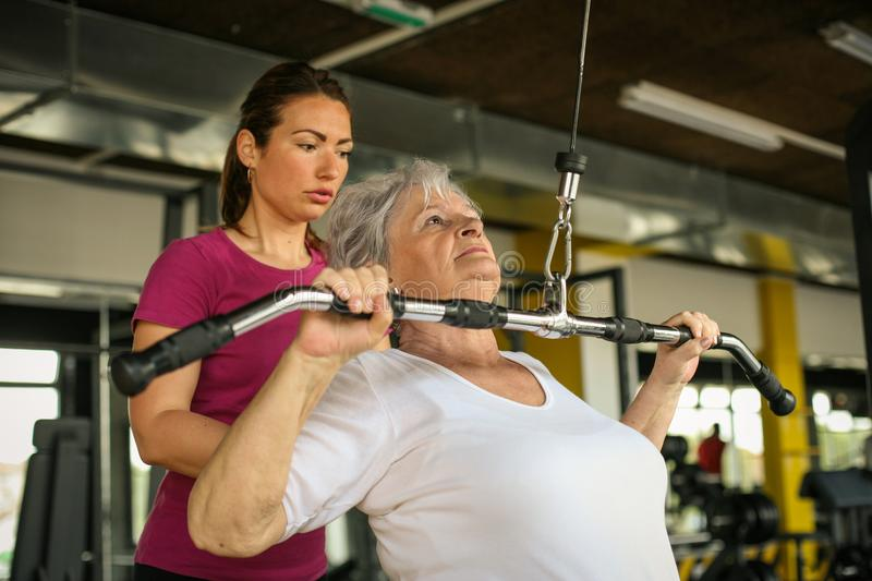 Active senior woman working exercise in the gym. stock image