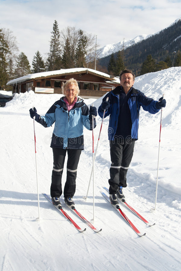 Active seniors. A senior couple outdoor in a winter setting. The active couple is about to go crosscountry skiing stock photo