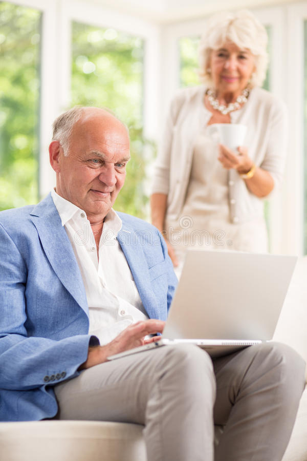 Active seniors with laptop royalty free stock photo