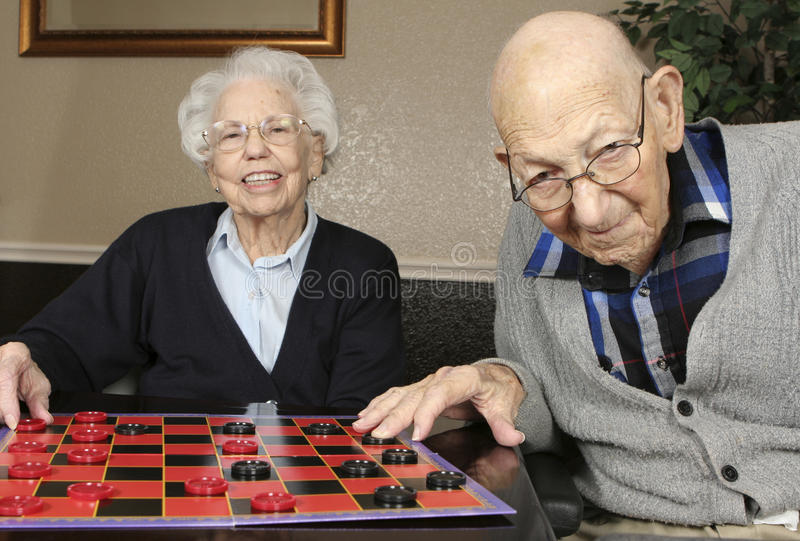 Download Active Seniors Playing Checkers Stock Photo - Image: 13774314