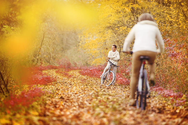 Active seniors riding bike stock images