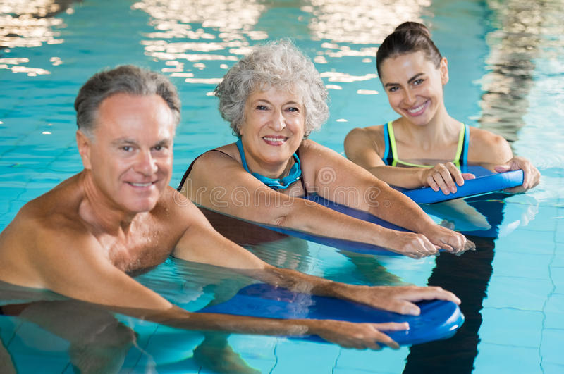 Active seniors at water fitness stock photo