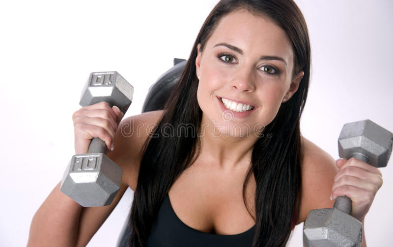 Active Smile Female Lifts Ten Pound Barbells Gym stock photos