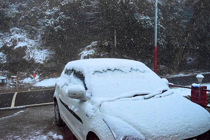 Active Snow Fall with Car covered with Snow - Winter in Uttarakhand, Himalayas, India stock image
