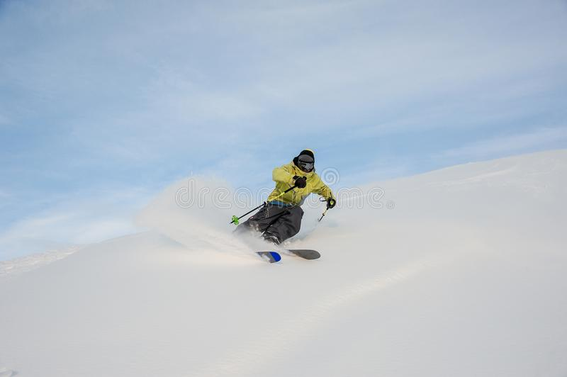 Active snowboarder sliding down the snowy hill stock photography