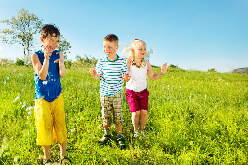 Active soaked kids royalty free stock photos