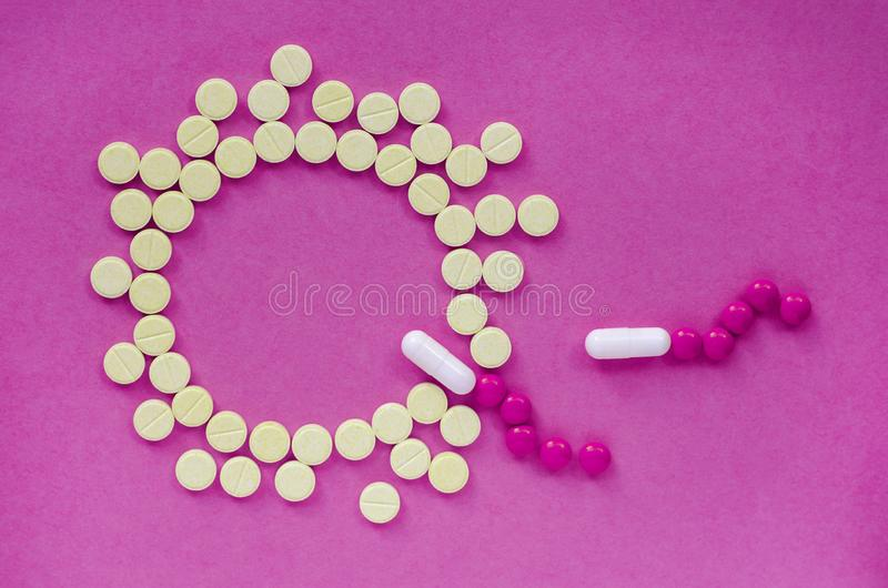 Active sperm swim to the egg. IVF. Active sperm swim to the egg on a pink background. The concept of pregnancy, fertilization of the egg. With the help of pills stock image