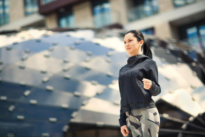Active, sporty dressed girl holding mobile phone royalty free stock images