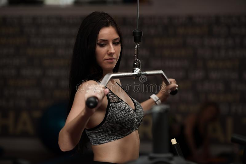 Active sporty woman workout arms in fitness club gym stock images