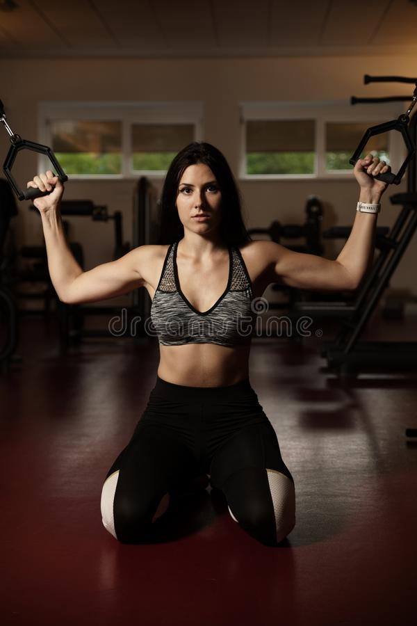 Active sporty woman workout arms in fitness club gym stock photos
