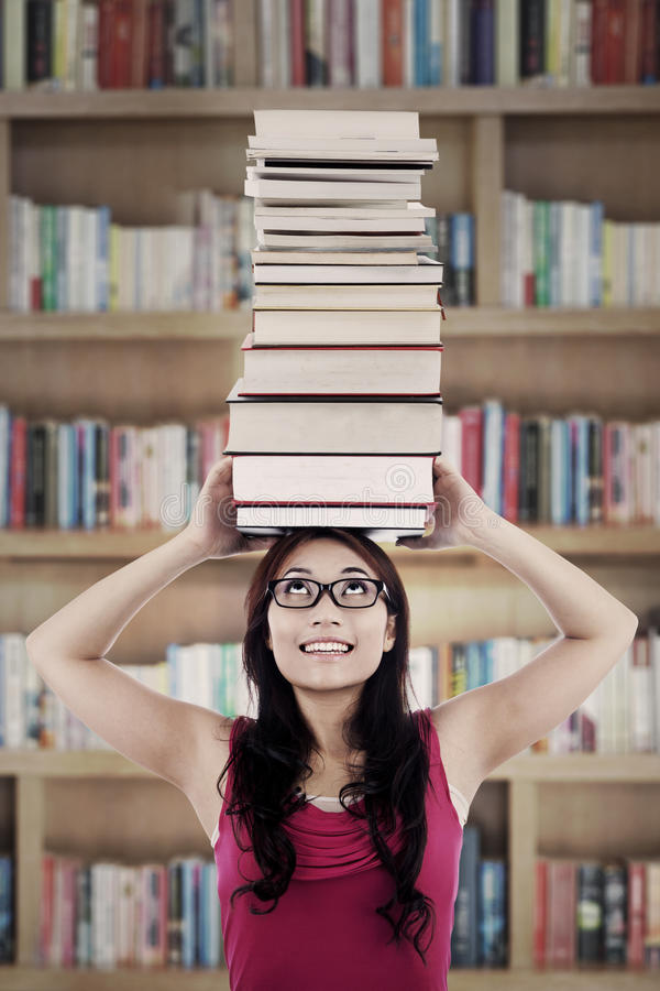 Download Active student in library stock image. Image of book - 26656459