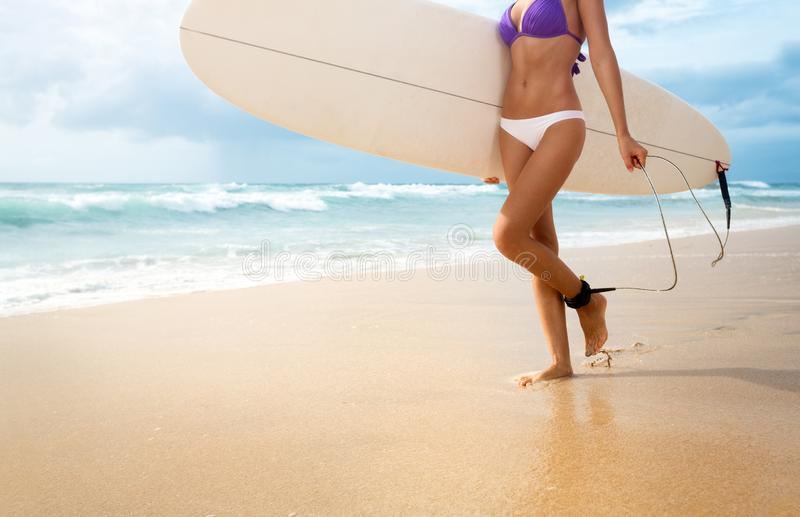 Active summer  vacation. Active summer  vacation, female holding surfboard royalty free stock images