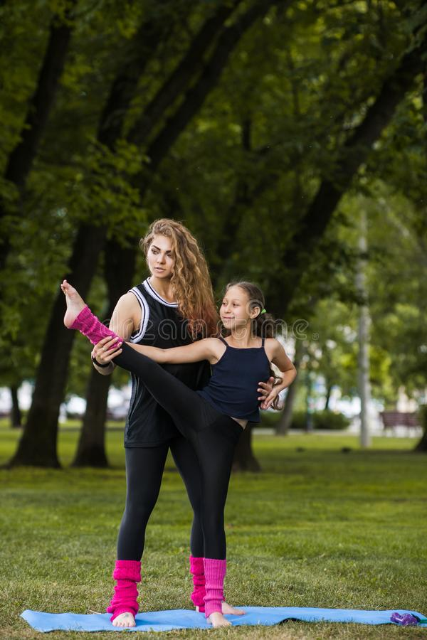 Active teenage sport. Family teamwork gymnastics. royalty free stock images