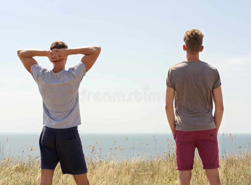 Active two man spending happy time on summer nature. stock images