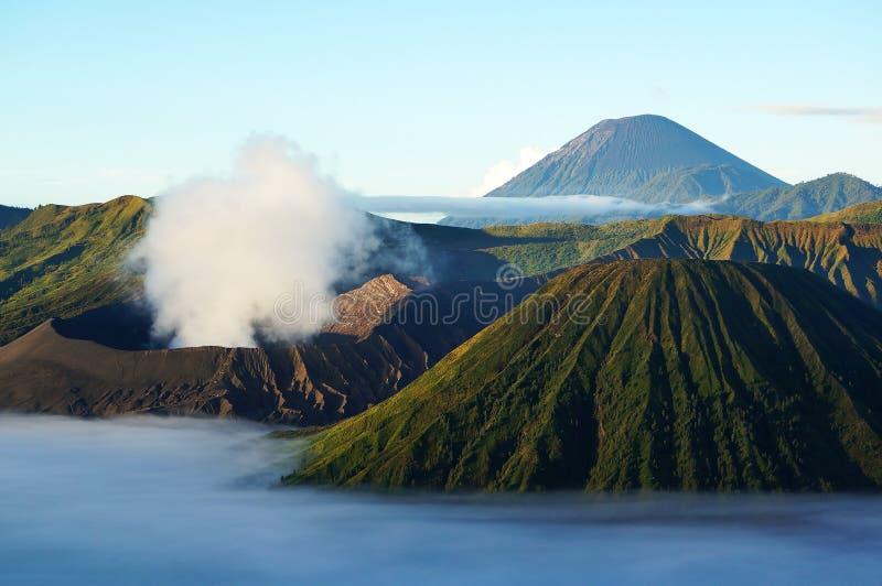 Active Volcano - Mount Bromo and Semeru. Active Volcano, Java, Indonsia - Mount Bromo (front-left). Taken not long after sunrise. Mount Semeru (back-right). Deep royalty free stock images