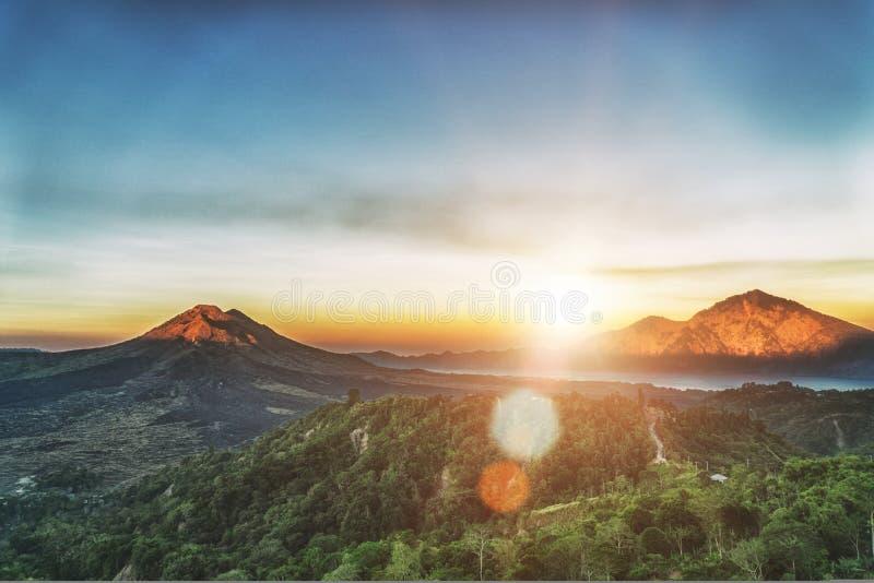 Active volcano Mount Gunung Batur at sunrise in Bali, Indonesia. stock photo