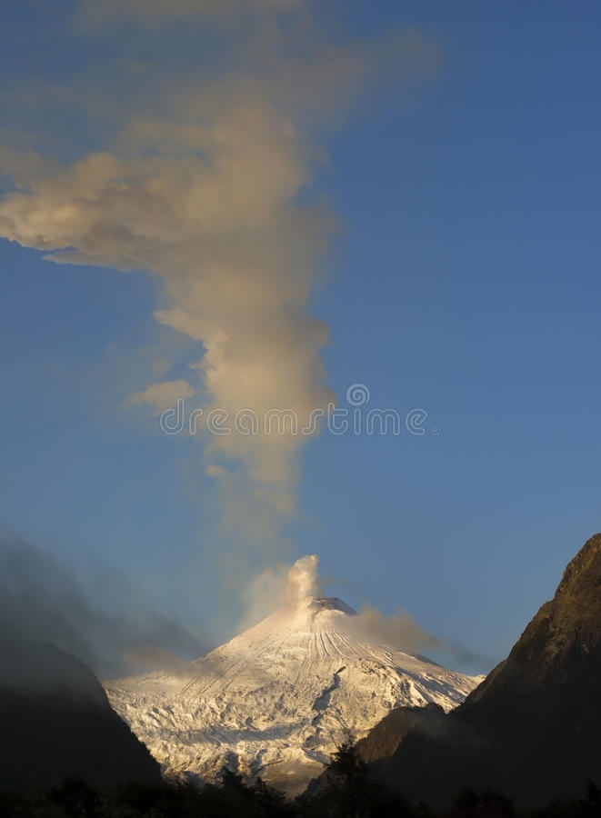 Active volcano Villarrica in the morning sun after a cold night with snow, at Pucon, Chile. stock photo