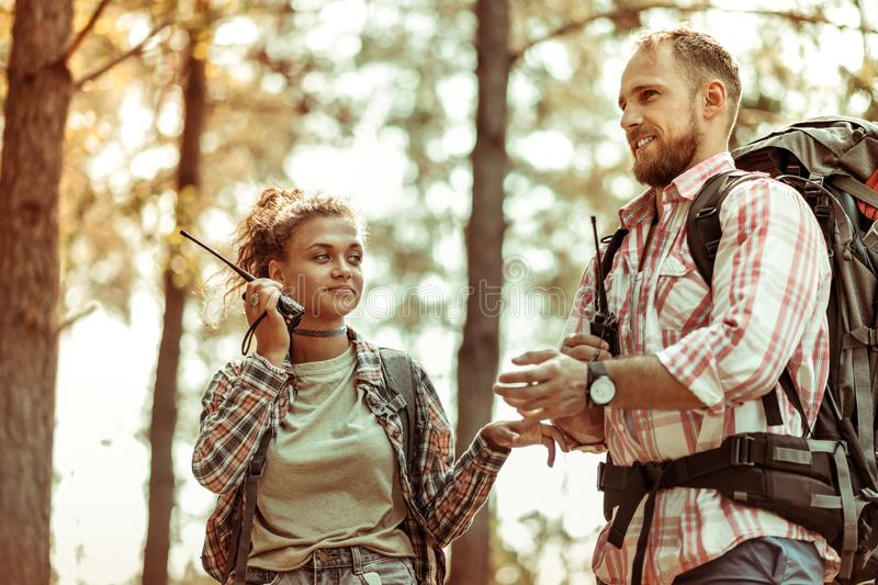 Happy joyful man hiking with his girlfriend royalty free stock photos