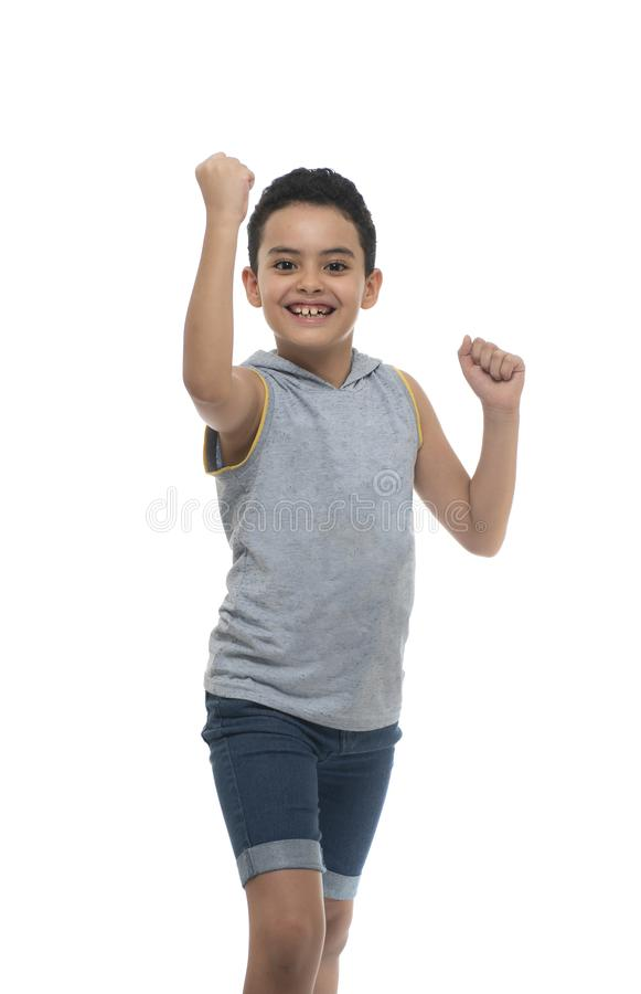 Active Winner Boy Smiling Over White Background royalty free stock image