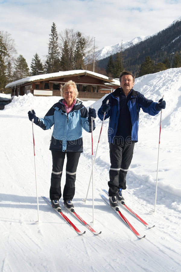 Active winter Seniors. A senior couple outdoor in a winter setting. The active couple is about to go crosscountry skiing royalty free stock photography