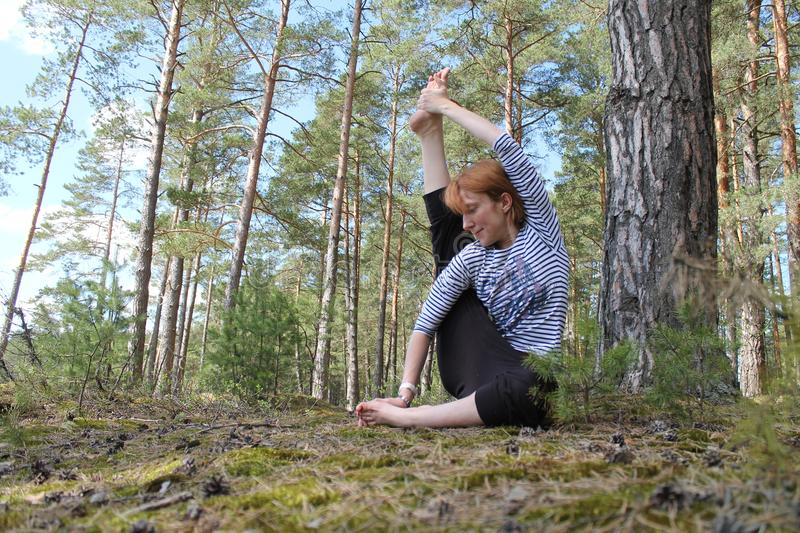Active woman. Beautiful active flexible woman made yoga class on the nature royalty free stock photo