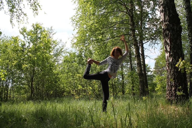 Active woman. Beautiful active flexible woman made yoga class on the nature stock images