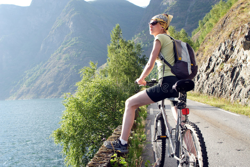 Active woman on bike is having break royalty free stock photography
