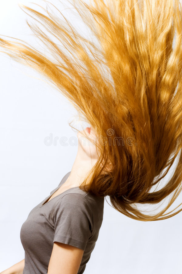 Active woman with hair in motion stock photo