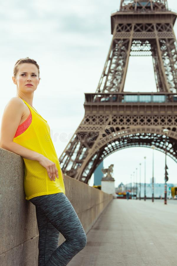 Active woman in Paris, France relaxing after workout royalty free stock photos