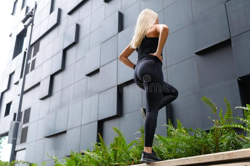 Active Woman Performing Step Workout Outdoor in the City royalty free stock image