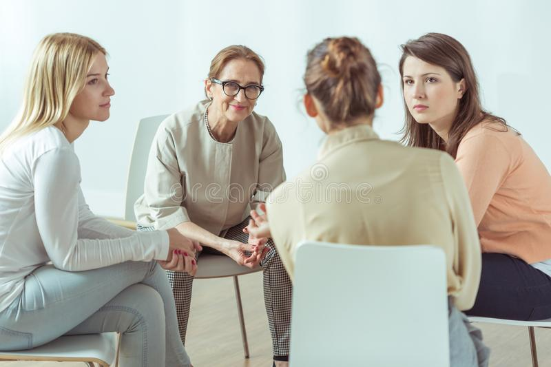 Active women on meeting. Active young women on mental training meeting stock photos
