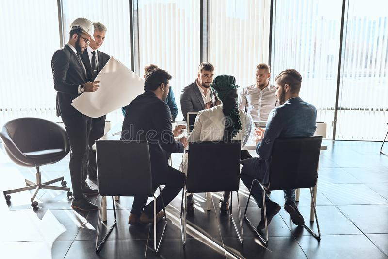 Active young businessmen are discussing a scheme of new project royalty free stock photos