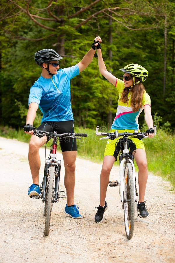 Free ACTIVE Young Couple Biking On A Forest Road In Mountain On A Spring Day Royalty Free Stock Photo - 109620105