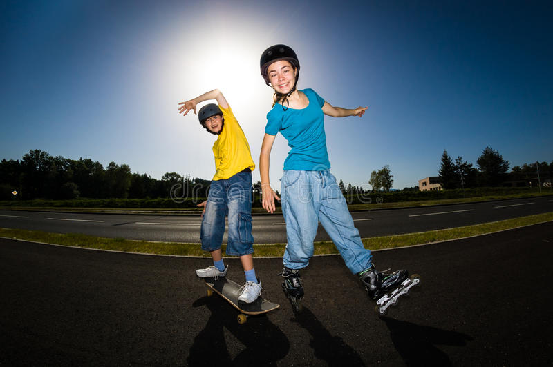 Active young people - rollerblading, skateboarding royalty free stock images