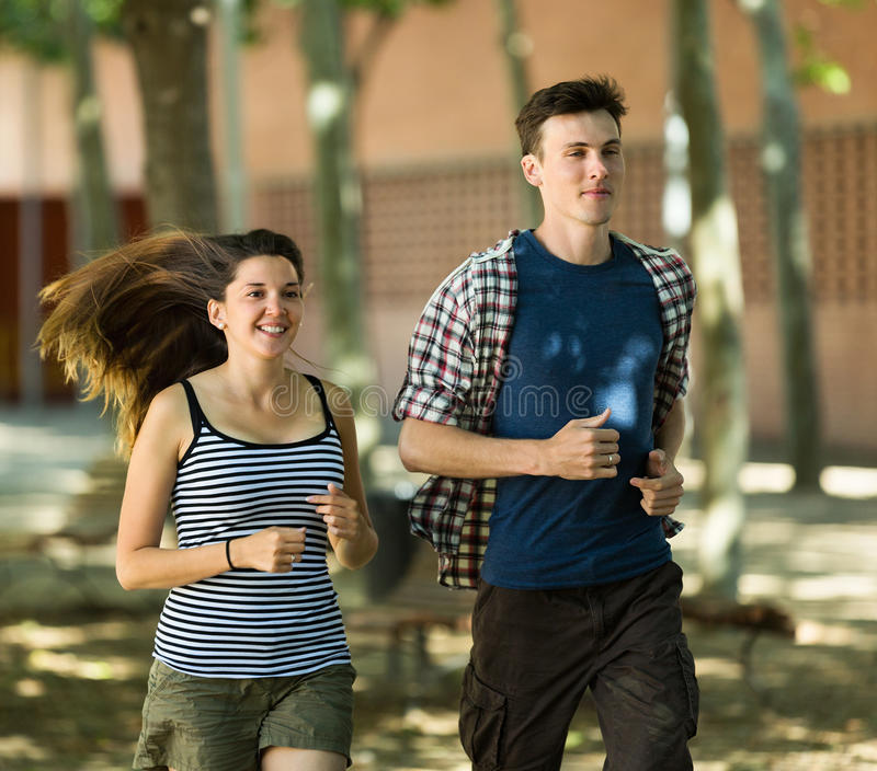Active young people running outdoor royalty free stock photos