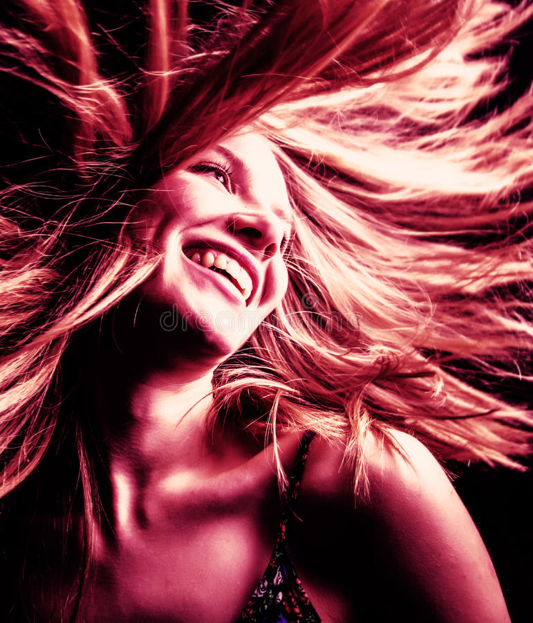 Active young woman with hair in motion stock photo