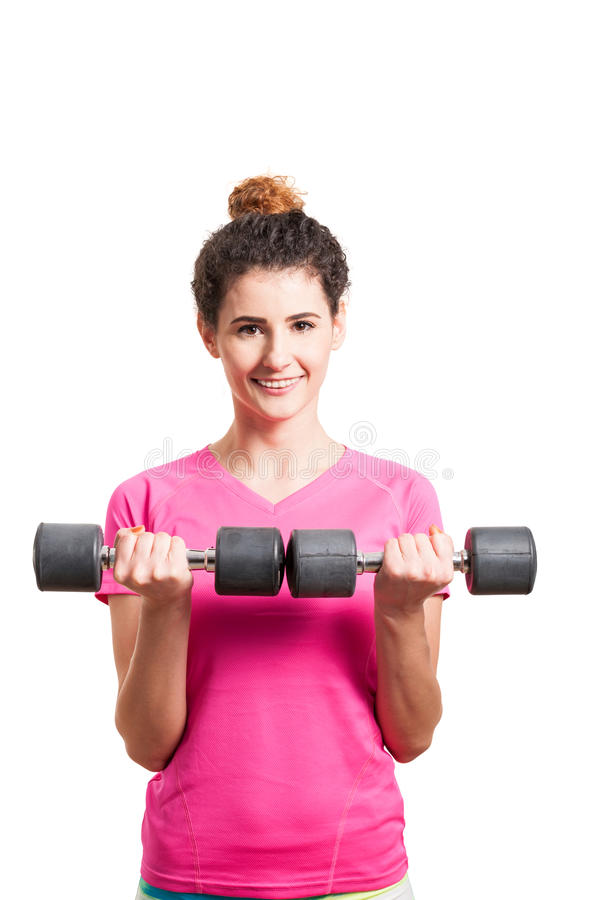 Active young woman working out with two dumbbells royalty free stock photography